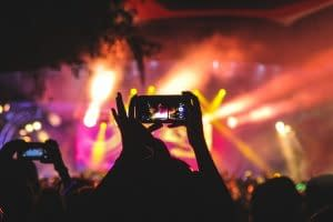 live streaming music festival on a mobile phone in the crowd