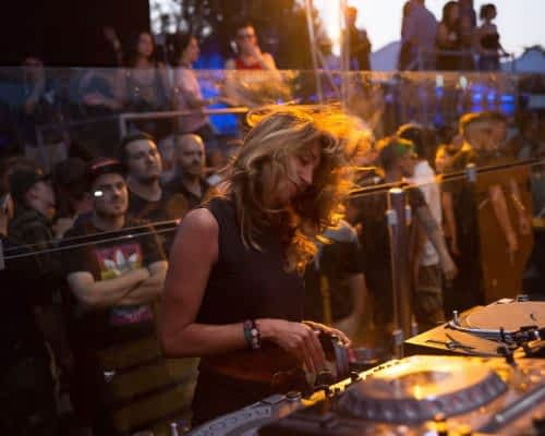 girl spinning the decks at a music festival